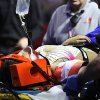 Photo - An injured female performer is lifted onto a stretcher after a platform collapsed during an aerial hair-hanging stunt at the Ringling Brothers and Barnum and Bailey Circus, Sunday, May 4, 2014, in Providence, R.I. At least nine performers were seriously injured in the fall, including a dancer below, while an unknown number of others suffered minor injuries. (AP Photo/Providence Journal, Bob Breidenbach) MANDATORY CREDIT; ONLINE OUT; RHODE ISLAND MEDIA OUT; NO SALES