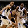 Photo - Los Angeles Lakers guard Derek Fisher, center, loses control of the ball against the defense of Dallas Mavericks guard Devin Harris, left, and guard Eddie Jones, right, in the first half of an NBA basketball game in Dallas, Friday, Jan. 25, 2008. (AP Photo/Tony Gutierrez) ORG XMIT: DNA103