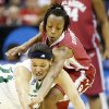 Photo - OU's Nyeshia Stevenson goes for the ball over Notre Dame's Ashley Barlow during the Sweet 16 round of the NCAA women's  basketball tournament in Kansas City, Mo., on Sunday, March 28, 2010. 