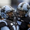 Photo - North Carolina's T.J. Thorpe, right, and Quinshad Davis (14) celebrate Davis' touchdown against Old Dominion during the first half of an NCAA college football game in Chapel Hill, N.C., Saturday, Nov. 23, 2013. North Carolina won 80-20.  (AP Photo/Gerry Broome)