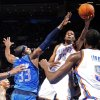 Oklahoma City\'s\' Kevin Durant (35) goes past Dallas\' Brendan Haywood (33) during a preseason NBA game between the Oklahoma City Thunder and the Dallas Mavericks at Chesapeake Energy Arena in Oklahoma City, Tuesday, Dec. 20, 2011. Photo by Bryan Terry, The Oklahoman