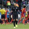 Photo - United States' goalkeeper Tim Howard reacts after Belgium's Kevin De Bruyne scored the opening goal during the World Cup round of 16 soccer match between Belgium and the USA at the Arena Fonte Nova in Salvador, Brazil, Tuesday, July 1, 2014. (AP Photo/Julio Cortez)