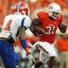 OSU\'s Jeremy Smith carries the ball against Savannah State\'s John Wilson (4) during a college football game between Oklahoma State University (OSU) and Savannah State University at Boone Pickens Stadium in Stillwater, Okla., Saturday, Sept. 1, 2012. Photo by Nate Billings, The Oklahoman