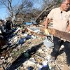 Chickasaw Nation employee Marcus Wilmond, helps clean up Shirley Mose\'s home following deadly storms around Lone Grove, Okla., Feb. 11, 2009. By John Clanton, The Oklahoman
