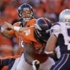 Denver Broncos quarterback Peyton Manning (18) passes during the second half of the AFC Championship NFL playoff football game against the New England Patriots in Denver, Sunday, Jan. 19, 2014. (AP Photo/Joe Mahoney)