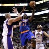 New York Knicks\' Ronnie Brewer (6) shoots over Phoenix Suns\' Marcin Gortat, of Poland, during the first half of an NBA basketball game on Wednesday, Dec. 26, 2012, in Phoenix. (AP Photo/Matt York)