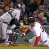 Photo - Atlanta Braves catcher Evan Gattis puts the tag on Boston Red Sox's Grady Sizemore, right, who is out trying to score on a fielder's choice in the sixth inning of a baseball game at Fenway Park in Boston, Wednesday, May 28, 2014. (AP Photo/Elise Amendola)