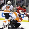 New Jersey Devils\' Dainius Zubrus, right rear, elebrates after scoring a goal against Philadelphia Flyers goalie Ilya Bryzgalov, while Flyers\' Scott Hartnell skates past during the second period of Game 4 of a second-round NHL hockey Stanley Cup playoff series, Sunday, May 6, 2012, in Newark, N.J. (AP Photo/Julio Cortez)