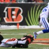 Photo - Indianapolis Colts wide receiver Da'Rick Rogers (16) runs past Cincinnati Bengals free safety Reggie Nelson on his way to a 69-yard touchdown after catching a pass in the second half of an NFL football game, Sunday, Dec. 8, 2013, in Cincinnati. (AP Photo/Tom Uhlman)