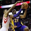 Los Angeles Lakers\' Kobe Bryant (24) goes to the basket against Houston Rockets\' Marcus Morris in the first half of an NBA basketball game, Tuesday, Dec. 4, 2012, in Houston. (AP Photo/Pat Sullivan)