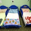 Tiny beds for toddlers are seen lined up in a row during a tour of the Pauline E. Mayer Children\'s Shelter in Oklahoma City, on Monday, Jan. 23, 2012. Photo by Jim Beckel, The Oklahoman