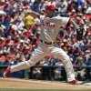 Photo - Philadelphia Phillies starting pitcher A.J. Burnett throws against the Chicago Cubs in the first inning of a   baseball game Sunday, June 15, 2014, in Philadelphia. (AP Photo/H. Rumph Jr)
