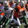 Oklahoma State\'s Jeremy Smith (31) runs past Baylor\'s Prince Kent (1) during the college football game between the Oklahoma State University Cowboys (OSU) and the Baylor University Bears at Boone Pickens Stadium in Stillwater, Okla., Saturday, Nov. 6, 2010. Photo by Chris Landsberger, The Oklahoman