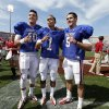 Quarterbacks Blake Bell (10), Kendal Thompson (1) and Trevor Knight (9) pose for a fan photograph after the annual Spring Football Game at Gaylord Family-Oklahoma Memorial Stadium in Norman, Okla., on Saturday, April 13, 2013. Photo by Steve Sisney, The Oklahoman