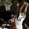 Oklahoma\'s Romero Osby (24) defends as Baylor\'s Isaiah Austin (21) goes up for a score in the second half of an NCAA college basketball game as Baylor\'s A.J. Walton (22) watches Wednesday, Jan. 30, 2013, in Waco, Texas. Oklahoma won 74-71. (AP Photo/Tony Gutierrez) ORG XMIT: TXTG111