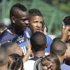 Photo - Italy's Mario Balotelli poses for photos with children prior to training in Mangaratiba, Brazil, Tuesday, June 17, 2014. Italy plays in group D at the soccer World Cup. (AP Photo/Antonio Calanni)