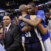 OKLAHOMA CITY ARENA / PLAYOFFS: Oklahoma City\'s Kevin Durant (35) hugs Shane Battier (31) of Memphis next to Memphis head coach Lionel Hollins, left, after game 7 of the NBA basketball Western Conference semifinals between the Memphis Grizzlies and the Oklahoma City Thunder at the OKC Arena in Oklahoma City, Sunday, May 15, 2011. The Thunder won, 105-90. Photo by Nate Billings, The Oklahoman ORG XMIT: KOD