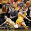 Tennessee\'s Taber Spani, right, keeps the ball in play as she collides with Vanderbilt guard Kady Schrann, left, in the first half of an NCAA college basketball game, Thursday, Jan. 24, 2013, in Nashville, Tenn. (AP Photo/Mark Humphrey)