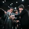 FILE - In this Feb. 9, 1964. file photo Paul McCartney, right, shows his bass guitar to Ed Sullivan before the Beatles\' live television appearance on