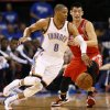 Oklahoma City\'s Russell Westbrook (0) drives the ball against Houston\'s Jeremy Lin (7) during Game 1 in the first round of the NBA playoffs between the Oklahoma City Thunder and the Houston Rockets at Chesapeake Energy Arena in Oklahoma City, Sunday, April 21, 2013. Photo by Nate Billings, The Oklahoman