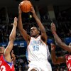 Oklahoma City\'s Kevin Durant puts up a shot in front of Philadelphia\'s Willie Green (left) and Jrue Holiday during the first half of their NBA basketball game at the Ford Center in Oklahoma City on Tuesday, Dec. 2, 2009. By John Clanton, The Oklahoman