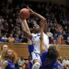 Photo - Duke's Elizabeth Williams drives to the basket over DePaul's Chanise Jenkins (13) during the first half of their second-round game in the NCAA basketball tournament in Durham, N.C., Monday, March 24, 2014.  (AP Photo/Ted Richardson)
