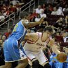 Houston Rockets\' Omer Asik (3) drives the ball around New Orleans Hornets\' Lance Thomas in the second half of a preseason NBA basketball game Friday, Oct. 12, 2012, in Houston. (AP Photo/Pat Sullivan)