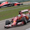 Photo - Ferrari driver Fernando Alonso of Spain, bottom, drives during the Chinese Formula One Grand Prix at Shanghai International Circuit in Shanghai, Sunday, April 20, 2014. (AP Photo/Eugene Hoshiko)