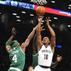 Brooklyn Nets\' Keith Bogans (10) takes aim over Boston Celtics\' Jason Terry (4) during the first half of an NBA basketball game on Thursday, Nov., 15, 2012, at Barclays Center in New York. (AP Photo/Kathy Kmonicek)