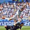 Photo - Argentina's Gonzalo Higuain leaps over Iran's goalkeeper Alireza Haghighi after taking a shot on goal during the group F World Cup soccer match between Argentina and Iran at the Mineirao Stadium in Belo Horizonte, Brazil, Saturday, June 21, 2014. (AP Photo/Martin Meissner)