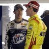 Drivers Brad Keselowski, left, and Joey Logano talk in the garage during practice for Sunday\'s NASCAR Sprint Cup series auto race at Martinsville Speedway in Martinsville, Va., Friday, April 5, 2013. (AP Photo/Steve Helber)