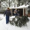 Photo - WINTER WEATHER / ICE STORM / WINTER STORM / SNOW STORM / AFTERMATH: Kelly Taylor (left) and Terry Butler, OG&E troublshooters, check the back yard of Geoffrey Wilson on Saturday, Jan. 30, 2010, in Norman, Okla.  Wilson's power lines were okay, but his cable television line was out.  Photo by Steve Sisney, The Oklahoman ORG XMIT: KOD