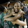 Edmond Santa Fe\'s Cameerah Graves (10) hugs Taylor Nashert (50) after the Class 6A girls high school basketball state tournament championship game between Edmond Santa Fe and Edmond Memorial at the Mabee Center in Tulsa, Okla., Saturday, March 10, 2012. Santa Fe won, 44-41. Photo by Nate Billings, The Oklahoman