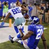 Photo -   New York Giants strong safety Kenny Phillips (21) reacts as Dallas Cowboys wide receiver Kevin Ogletree (85) celebrates catching a touchdown pass during the second half of an NFL football game, Wednesday, Sept. 5, 2012, in East Rutherford, N.J. (AP Photo/Julio Cortez)