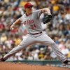 Photo - Cincinnati Reds starting pitcher Homer Bailey delivers during the first inning of a baseball game against the Pittsburgh Pirates in Pittsburgh, Thursday, June 19, 2014. (AP Photo/Gene J. Puskar)