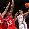 Oklahoma City\'s Thabo Sefolosha looks for an open teammate against pressure from Philadelphia\'s Jason Smith and Elton Brand during the first half of their NBA basketball game at the Ford Center in Oklahoma City on Tuesday, Dec. 2, 2009. By John Clanton, The Oklahoman