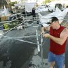Marty Sidders tries to repair the framework of a tent after overnight winds toppled tents and destroyed artists\' works at the Edmond Arts Festival in downtown Edmond, OK, Friday, May 2, 2008. BY PAUL HELLSTERN, THE OKLAHOMAN
