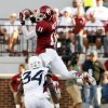 Oklahoma\'s Lacoltan Bester (11) catches a pass over Ishmael Banks (34) during a college football game between the University of Oklahoma Sooners (OU) and the West Virginia University Mountaineers at Gaylord Family-Oklahoma Memorial Stadium in Norman, Okla., on Saturday, Sept. 7, 2013. Photo by Steve Sisney, The Oklahoman