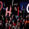 "Photo -   Supporters spell out ""Ohio"" as they cheer for Republican presidential candidate, former Massachusetts Gov. Mitt Romney, not pictured, as he speaks during a campaign event at The Square at Union Centre, Friday, Nov. 2, 2012, in West Chester, Ohio. (AP Photo/David Goldman)"