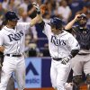 Photo - Tampa Bay Rays' Ryan Hanigan, center, is congratulated on his two-run home run by teammate Wil Myers in front of New York Yankees catcher Brian McCann during the fourth inning of a baseball game Saturday, April 19, 2014, in St. Petersburg, Fla. (AP Photo/Mike Carlson)