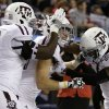 Texas A&M\'s Jarvis Harrison (51) and Uzoma Nwachukwu, right, celebrate with Ryan Swope, center, following his touchdown in the second half of the Cotton Bowl NCAA college football game against Oklahoma on Friday, Jan. 4, 2013, in Arlington, Texas. (AP Photo/LM Otero)