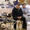 Donald and Helen Capps of Joplin, Mo., sit in a temporary Red Cross shelter at the Robert Ellis Young Gymnasium at Missouri Southern State University in Joplin, Mo., Monday, May 23, 2011. The Capps lost their home after a destructive tornado moved through Joplin on Sunday evening, killing at least 89 people and injuring hundreds more. (AP Photo/Mark Schiefelbein) ORG XMIT: MOMS101