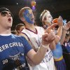 Deer Creek senior Curt Waugh, left, cheers for the Lady Antlers during the state high school championhips. Community Photo By: Bill Waugh Submitted By: Bill, fairfax