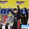 Driver Regan Smith celebrates in Victory Lane after winning the NASCAR Nationwide Series auto race at the Talladega Superspeedway in Talladega, Ala., Saturday, May 4, 2013. (AP Photo/Rainier Ehrhardt)