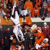 BEDLAM / FLIP: Oklahoma quarterback Sam Bradford (14) is flipped upside down as he leaps over Oklahoma State\'s Orie Lemon (41) during the second half of the college football game between the University of Oklahoma Sooners (OU) and Oklahoma State University Cowboys (OSU) at Boone Pickens Stadium on Saturday, Nov. 29, 2008, in Stillwater, Okla. STAFF PHOTO BY CHRIS LANDSBERGER ORG XMIT: KOD
