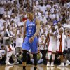 Oklahoma City\'s Russell Westbrook (0) walks off the court as Miami\'s Dwyane Wade (3) and Chris Bosh (1) celebrate after Game 3 of the NBA Finals between the Oklahoma City Thunder and the Miami Heat at American Airlines Arena, Sunday, June 17, 2012. Oklahoma CIty lost 91-85. Photo by Bryan Terry, The Oklahoman