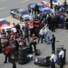 Photo - Drivers wait in the pit area before their qualifying session for the NASCAR Sprint Cup series Quicken Loans 400 auto race at Michigan International Speedway in Brooklyn, Mich., Friday, June 13, 2014. (AP Photo/Carlos Osorio)