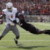 Oklahoma State Cowboys\'s Joseph Randle (1) tries to get by Daniel Cobb (42) during a college football game between Texas Tech University (TTU) and Oklahoma State University (OSU) at Jones AT&T Stadium in Lubbock, Texas, Saturday, Nov. 12, 2011. Photo by Sarah Phipps, The Oklahoman ORG XMIT: KOD