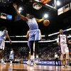 Denver Nuggets\' Andre Iguodala (9) reacts after dunking the ball as Phoenix Suns\' Michael Beasley (0) watches during the first half of an NBA basketball game, Monday, Nov. 12, 2012, in Phoenix. (AP Photo/Ross D. Franklin)
