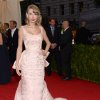"""Taylor Swift attends The Metropolitan Museum of Art\'s Costume Institute benefit gala celebrating """"Charles James: Beyond Fashion"""" on Monday, May 5, 2014, in New York. (Photo by Evan Agostini/Invision/AP)"""